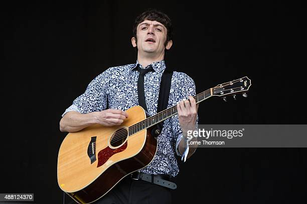 John Dagleish performs with the cast of Sunny Afternoon on the Main Stage at Blackheath Common on September 13 2015 in London England