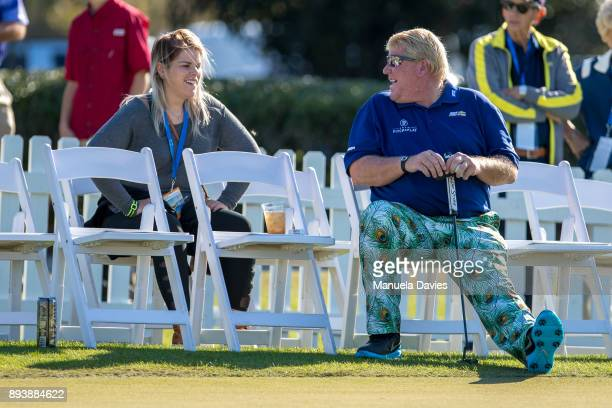 John Daly and his daughter chat on the putting green before the third round of the PNC Father/Son Challenge at The RitzCarlton Golf Club on December...