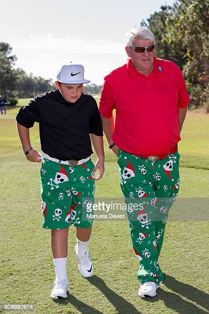 John Daly and his son Little John get ready to tee off on the first tee during the first round of the PNC Father/Son Challenge at The RitzCarlton...