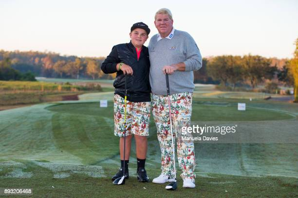 John Daly and his son Little John pose for a photo on the 10th tee during the first round of the PNC Father/Son Challenge at The RitzCarlton Golf...