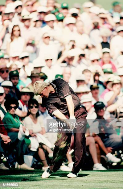 John Daly blasts off the tee box in front of a large gallery during the 1993 Masters Tournament at Augusta National Golf Club on April 1993 in...
