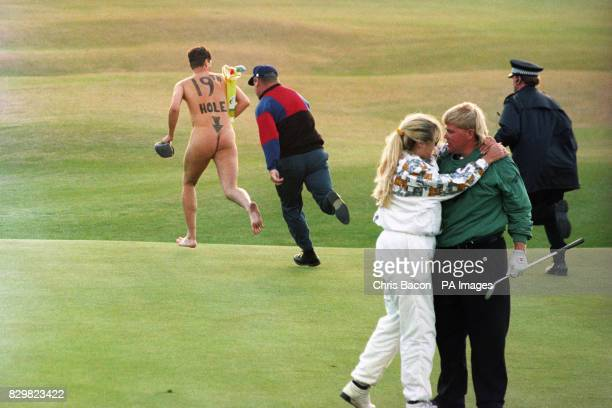 John Daly celebrates with his wife Paulette after clinching the Open after beating Costantino Rocca in tonight's playoff as a streaker runs onto the...