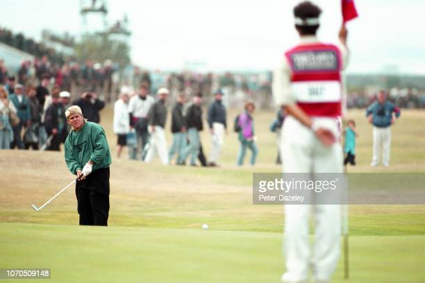 John Daly chipping to green during the 1995 Open Championship on 20–23 July1995 at the Old Course at St Andrews in St Andrews Scotland John Daly won...