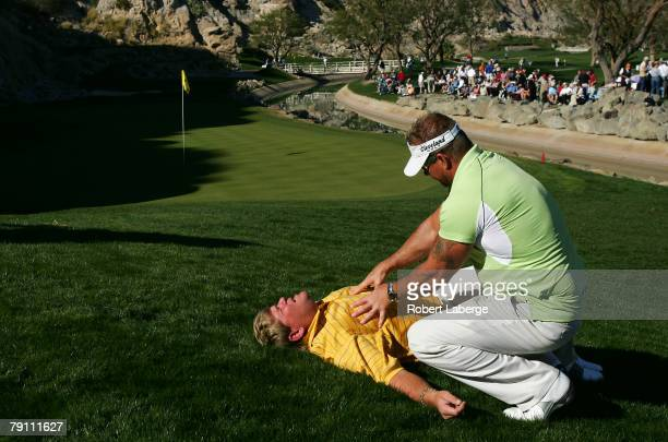 John Daly gets a massage from chronic pain specialist Jim Weathers next to the 17th green during the third round of the 49th Bob Hope Chrysler...