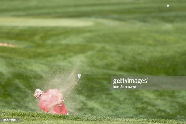 John Daly gets out of the sand and onto the green at eighteen during the final round of the American Family Insurance Championship Champions Tour...