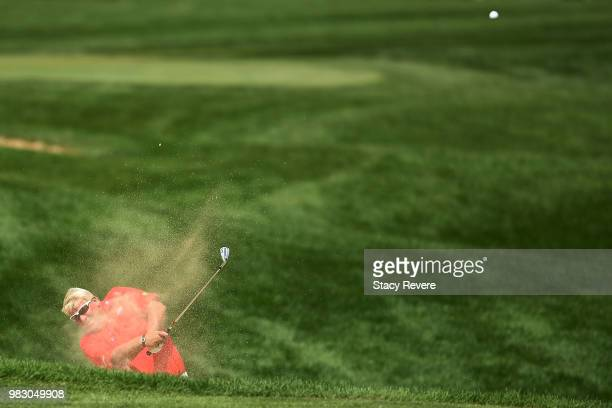 John Daly hits his second shot on the 18th hole during the third and final round of the American Family Championship at University Ridge Golf Course...