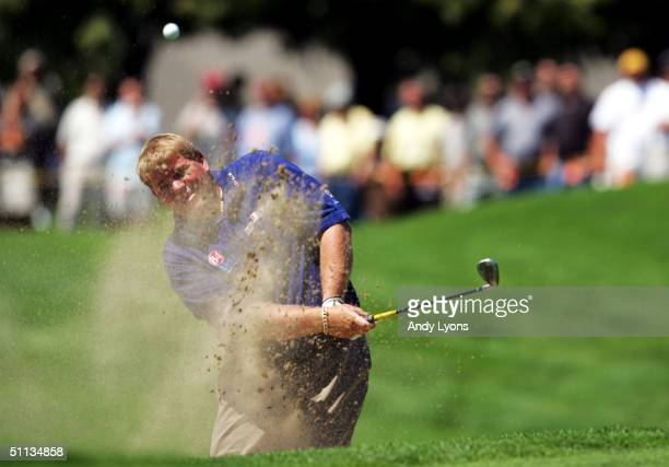 John Daly hits his third shot on the par five first hole during the final round of the Buick Open on August 1 2004 at Warwick Hills Golf and Country...