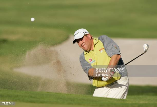 John Daly hits out of a bunker during the first round of the Fryscom Open benefiting Shriners Hospitals for Children at TPC Canyons on October 11...