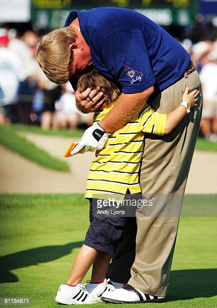 John Daly hugs his son austin after finishing second in the Buick Open on August 1 2004 at Warwick Hills Golf and Country Club in Grand Blanc Michigan