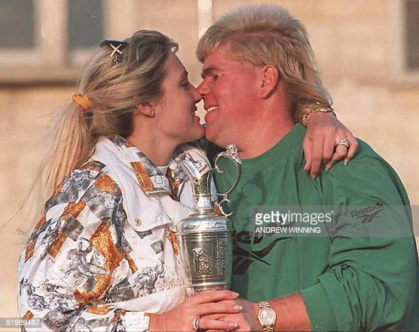 John Daly kisses his wife Paulette after Daly beat Costantino Rocca of Italy in a playoff to take the British Open Golf Championship on the Old...