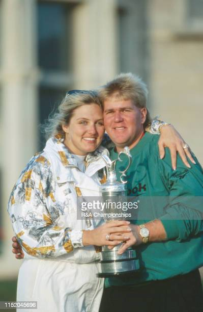 John Daly of the United States and his wife Paulette pose with the Claret Jug following his victory during The 124th Open Championship held on the...
