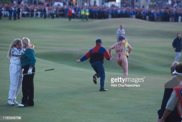 John Daly of the United States and his wife Paulette react following his victory as a Streaker runs across the 18th green during The 124th Open...