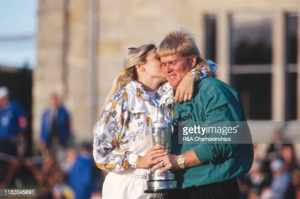 John Daly of the United States gets a kiss from his wife Paulette following his victory during The 124th Open Championship held on the Old Course at...