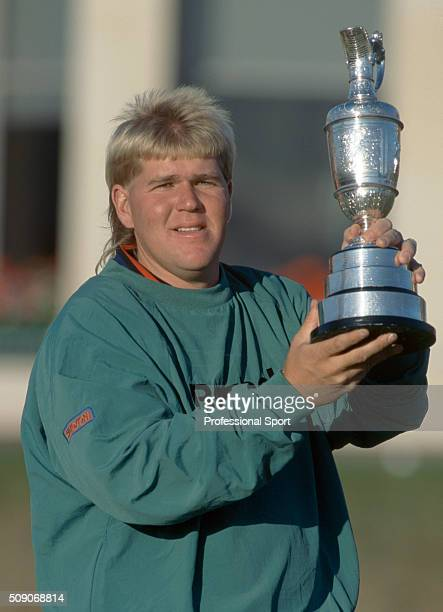 John Daly of the United States holds the Claret Jug after winning the British Open Golf Championship held at The Old Course in St Andrews Scotland on...
