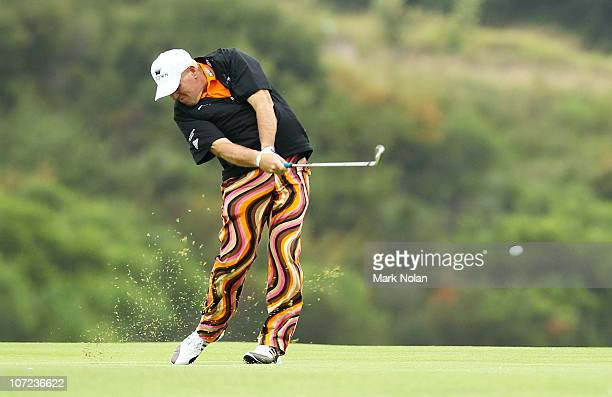 John Daly of the United States plays a shot on the 17th hole during day one of the Australian Open at The Lakes Golf Club on December 2 2010 in...