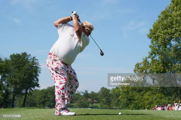 John Daly of the United States plays his shot from the second tee during the first round of the 2018 PGA Championship at Bellerive Country Club on...