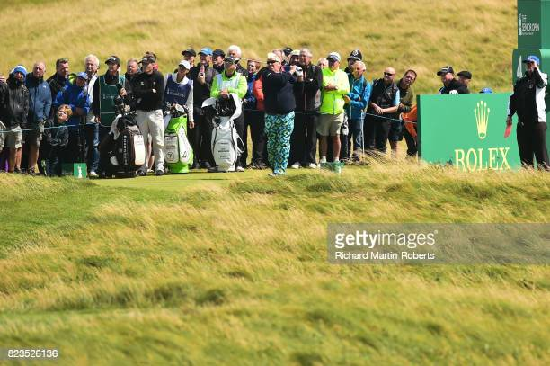 John Daly of the United States tees off on the 4th hole during the first round of the Senior Open Championship presented by Rolex at Royal Porthcawl...