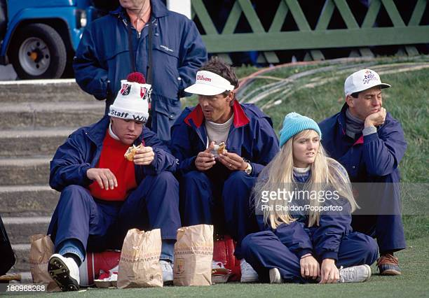John Daly of the United States with caddie Greg Rita eating hamburgers during a break at the Alfred Dunhill Cup held at the Old Course at St Andrews...