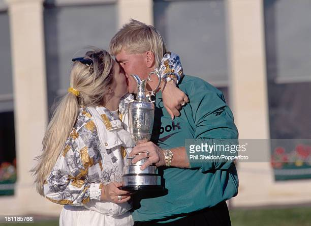 John Daly of the United States with his wife Paulette holding the trophy after winning the British Open Golf Championship held at the Old Course at...