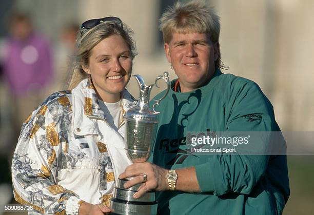 John Daly of the United States with his wife Paulette holding the Claret Jug after winning the British Open Golf Championship held at The Old Course...