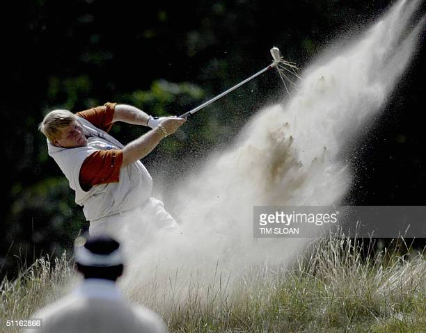 John Daly of the US hits from the deep rough along the 18th fairway during the first round of the 86th PGA Championship at the Whistling Straits Golf...