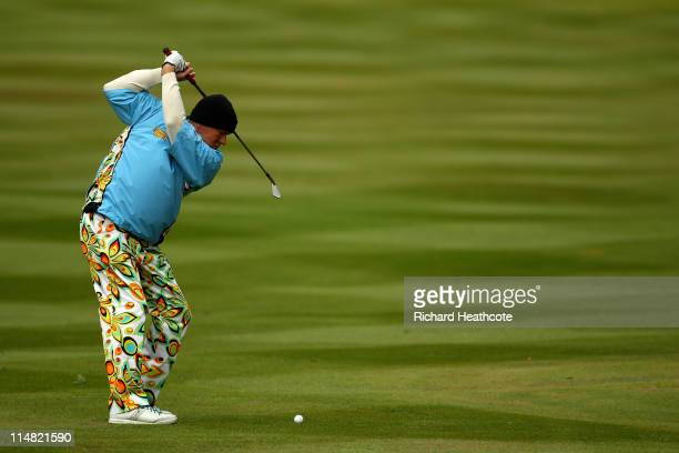 John Daly of the USA hits his approach shot on the 3rd hole during the second round of the BMW PGA Championship at the Wentworth Club on May 27 2011...