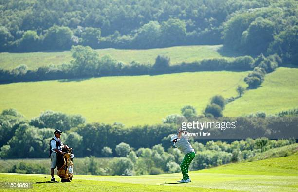 John Daly of the USA plays his second shot into the 16th green during the first round of the Saab Wales Open on the Twenty Ten course at the Celtic...