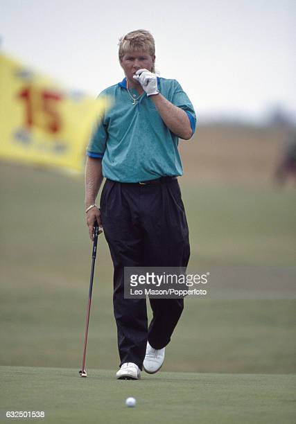John Daly of the USA smoking a cigarette during the British Open Golf Championship at Royal St George's Golf Club in Sandwich circa July 1993