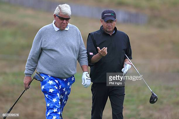 John Daly of United States and Paul Eales of England chat from the 3rd tee during the final round of the Paris Legends Championship played on...