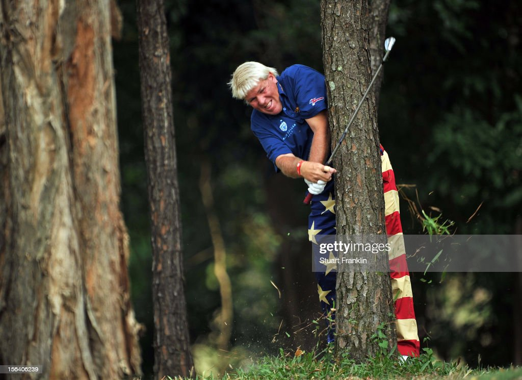 John Daly of USA plays a shot from the trees during the first round of the UBS Hong Kong open at The Hong Kong Golf Club on November 15, 2012 in Hong Kong, Hong Kong.
