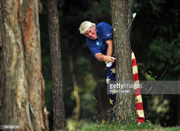John Daly of USA plays a shot from the trees during the first round of the UBS Hong Kong open at The Hong Kong Golf Club on November 15 2012 in Hong...