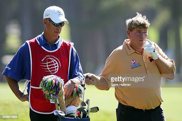 John Daly pulls a club on the ninth hole as his caddie Peter Van de Reit looks on during the first round of the WGC American Express Championship at...