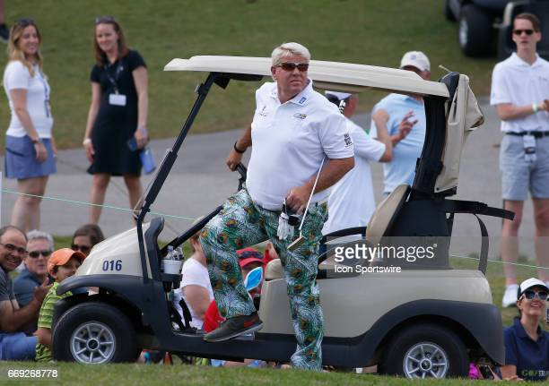 John Daly pulls up to the 18th green in his golf cart during the final round of the Mitsubishi Electric Classic tournament at the TPC Sugarloaf Golf...