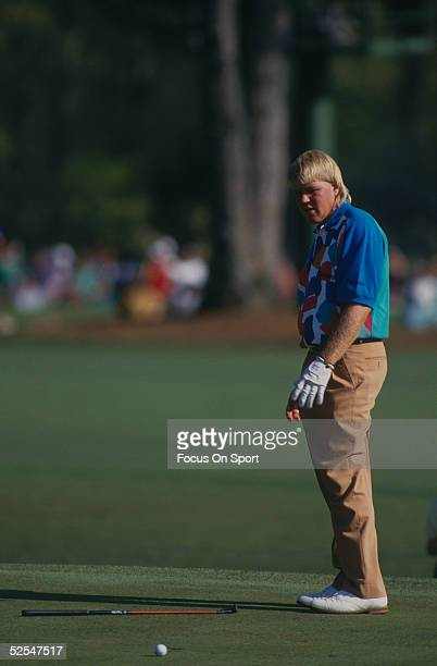 John Daly reacts to a missed putt by dropping his putter in shock during the 1992 Masters Tournament