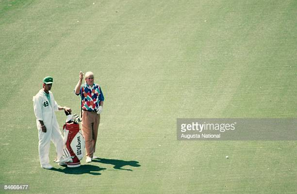 John Daly selects a club on the fairway during the 1993 Masters Tournament at Augusta National Golf Club on April 1993 in Augusta Georgia