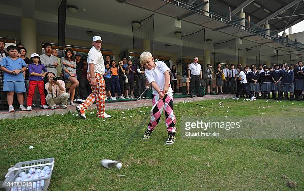 John Daly son of golfer John Daly of USA hits a ball as he is watched by pupils from local schools during a golf clinic prior to the start of the UBS...