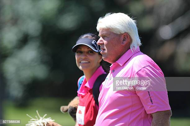 John Daly USA with his caddie girlfriend Anna Cladakis during the third round of the Travelers Championship at the TPC River Highlands Cromwell...