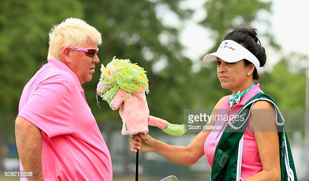 John Daly waits alongside his girlfriend/caddie Anna Cladakis on the practice ground during the final round of the Insperity Invitational at The...