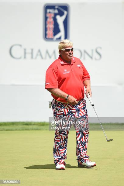 John Daly waits to putt on the 18th green during the third and final round of the American Family Championship at University Ridge Golf Course on...