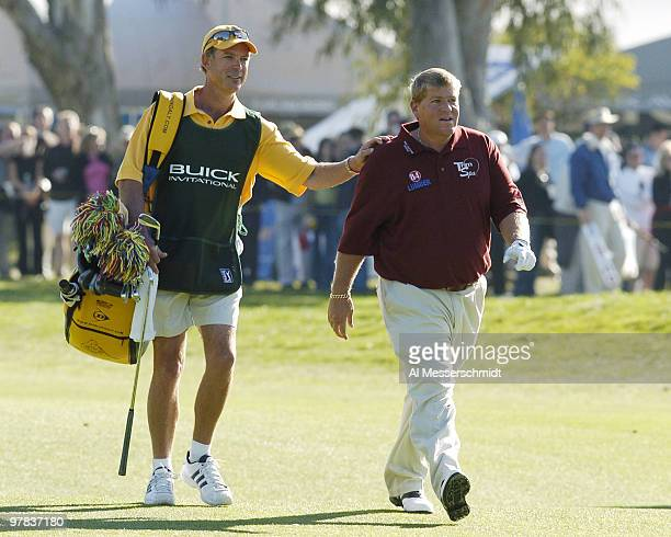John Daly walks the 18th fairway en route to an eagle at Torrey Pines Golf Course site of the Buick Invitational during thirdround play February 14...