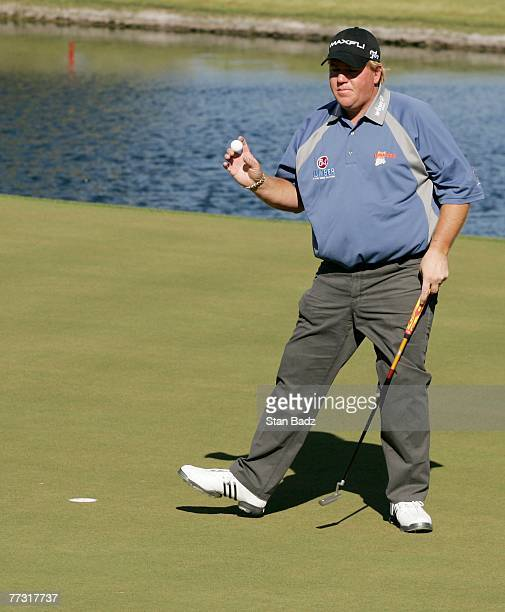John Daly waves to the gallery during the third round of the Fryscom Open benefiting Shriners Hospitals for Children at TPC Summerlin on October 13...