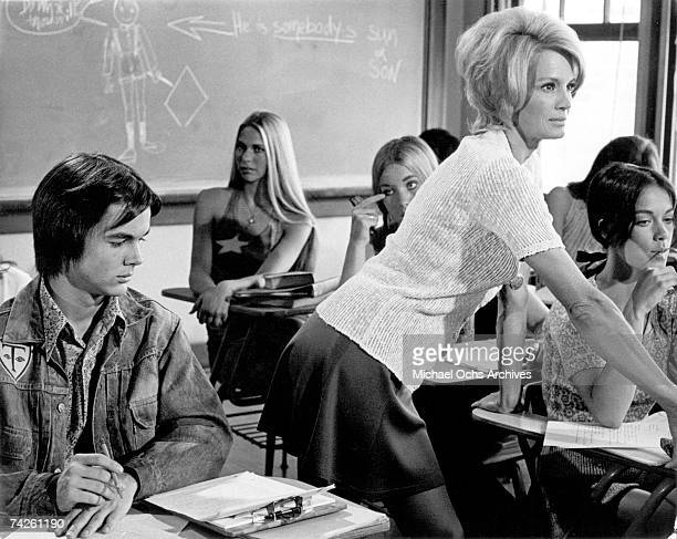 John David Carson looking at Angie Dickinson in 'Pretty Maids All in a Row' a 1971 film Photo by Michael Ochs Archives/Getty Images