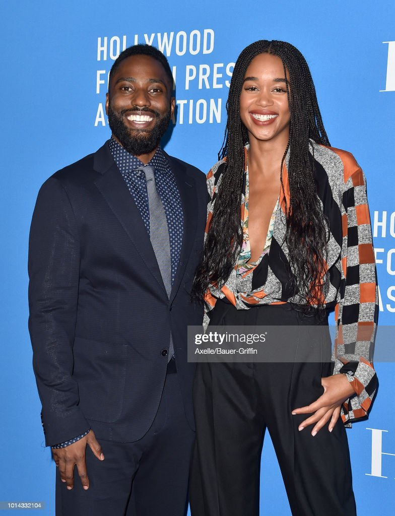 John David Washington and Laura Harrier arrive at the Hollywood Foreign Press Association's Grants Banquet at The Beverly Hilton Hotel on August 9, 2018 in Beverly Hills, California.