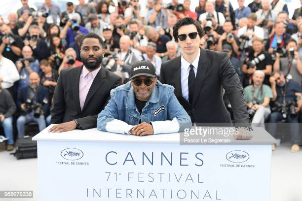 John David Washington director Spike Lee and actor Adam Driver attend the photocall for BlacKkKlansman during the 71st annual Cannes Film Festival at...