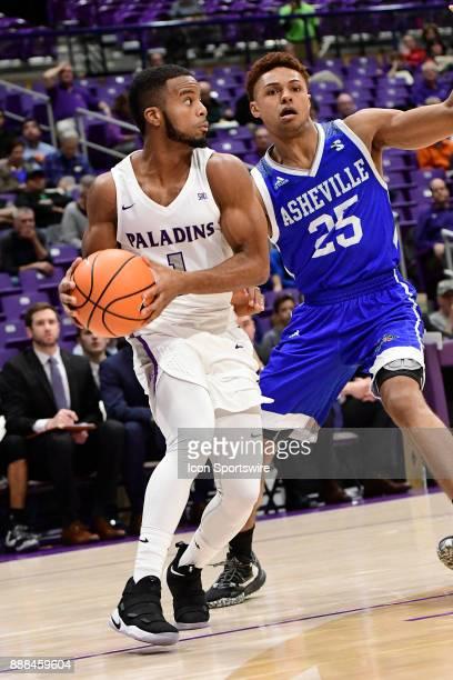 John Davis III guard Furman University Paladins challenges MaCio Teague guard UNC Asheville Bulldogs Tuesday December 5 at Timmons Arena in...