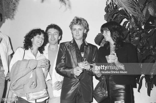 John Deacon and Roger Taylor with his wife Dominique Beyrand of Queen at the afterparty of an Adam The Ants show Los Angeles United States 14...