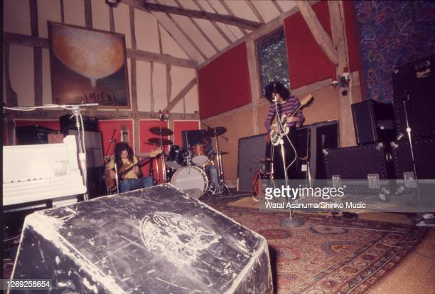 John Deacon, Roger Taylor, Brian May of Queen rehearsing and recording 'A Night At The Opera' album at Ridge Farm Studios, West Sussex, United...