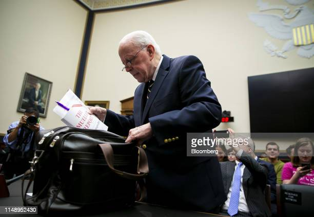 John Dean former White House counsel takes out a copy of the Mueller report prior to a hearing in Washington DC US on Monday June 10 2019 House...