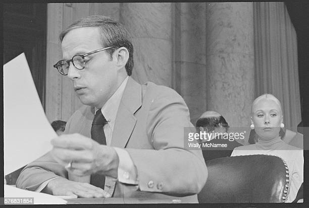 John Dean presidential adviser and Watergate conspirator testifies before a Senate committee during the Watergate Hearings His wife Maureen sits...