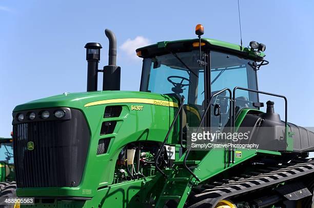 john deer farm equipment - john deere tractor stock photos and pictures